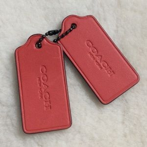 Coach leather tags, keychains, red